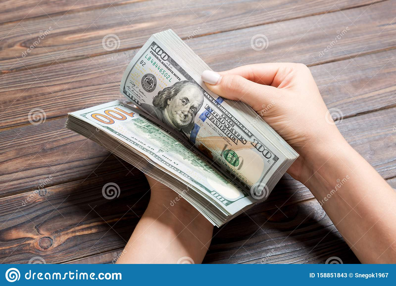 Businesswoman S Hands Counting One Hundred Dollar Bills On