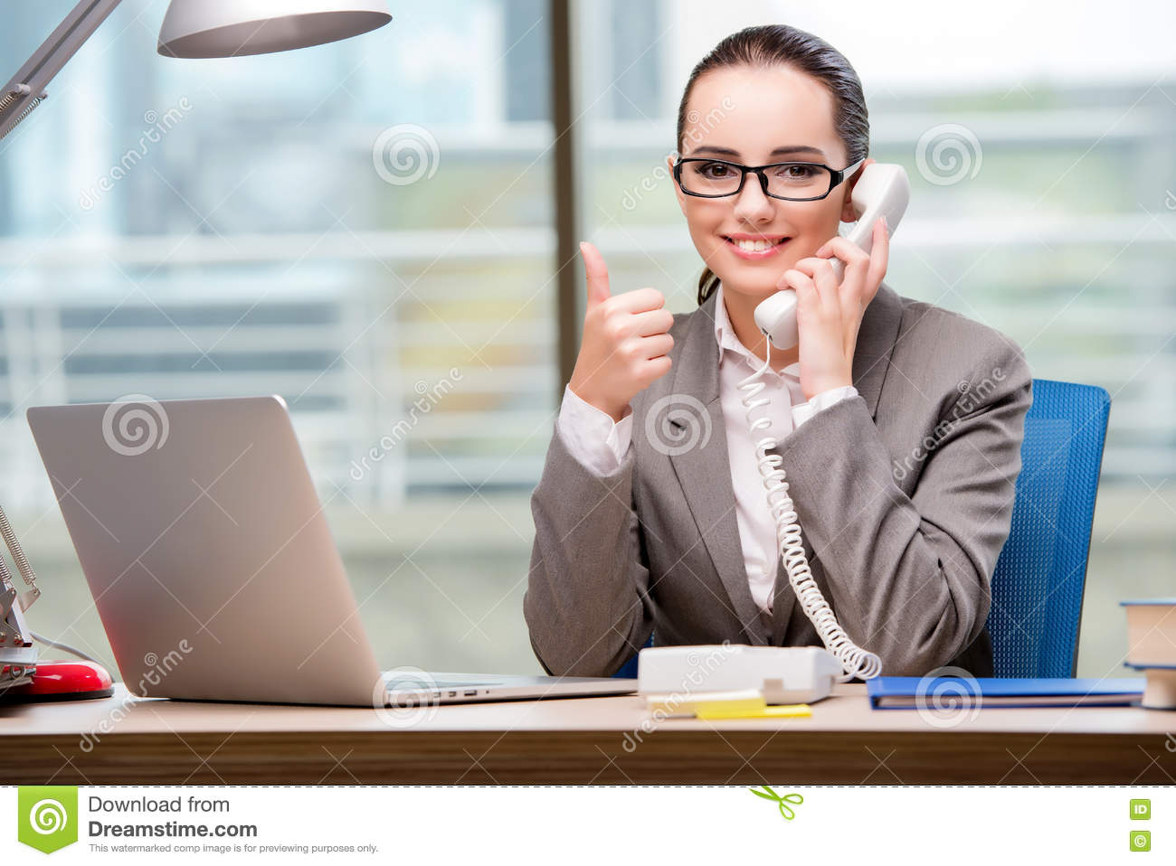 The Call Center Operator Working At Her Desk Stock Photo