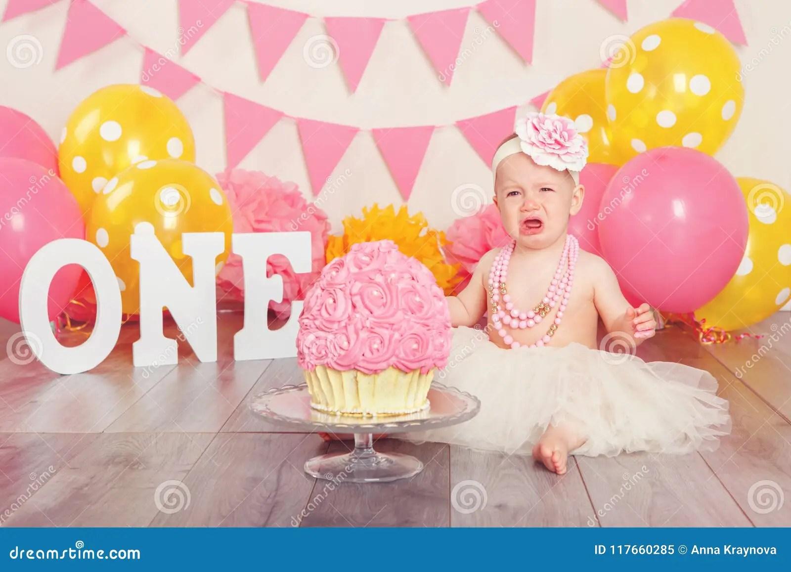 Caucasian Baby Girl In Tutu Tulle Skirt Celebrating Her First Birthday Cake Smash Concept Stock Image Image Of Eating Pink 117660285