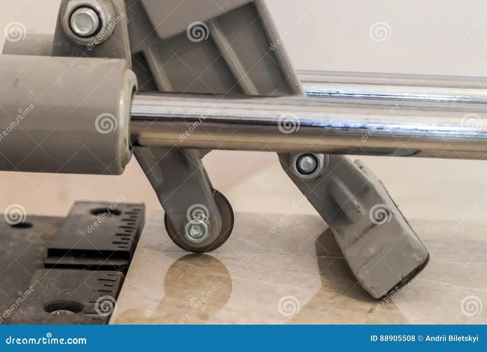 ceramic tiles and tools for tiler floor tiles installation home improvement renovation ceramic tile cutting tool stock photo image of black flooring 88905508