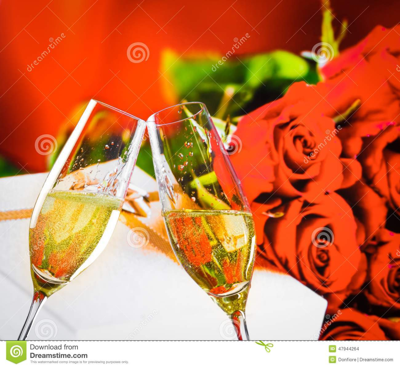 Champagne Flutes With Golden Bubbles On Wedding Roses Flowers Background Stock Photo Image
