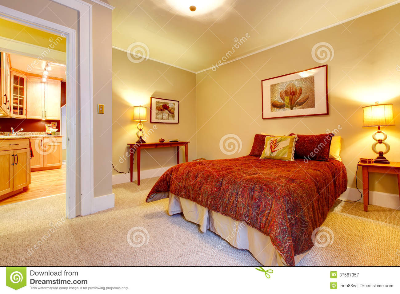 Charming Bedroom With Beautiful Red Bedding Royalty Free