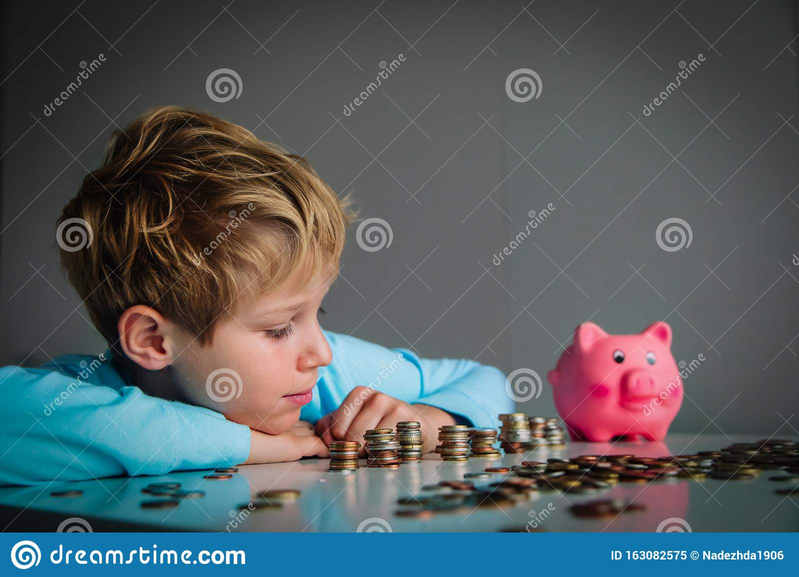 Child Counting Money Boy Put Coins Into Piggy Bank Stock