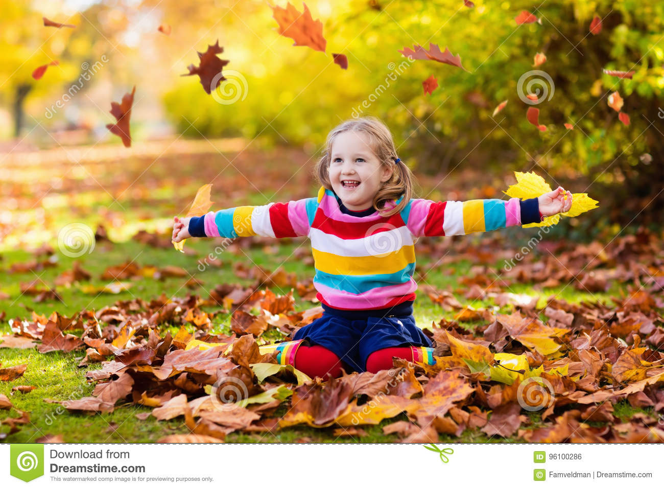 Child In Fall Park Kid With Autumn Leaves Stock Photo