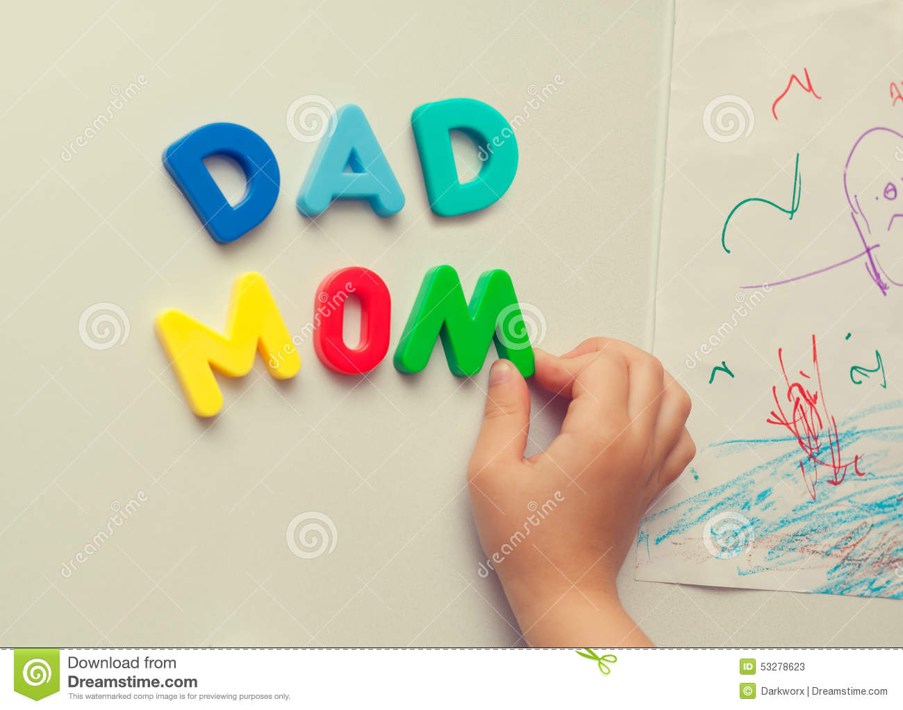 Child Forms Mom Dad Words On Refrigerator Stock Photo