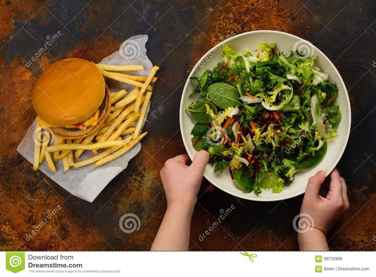 Child Making Choice Between Healthy Salad And Fast Food