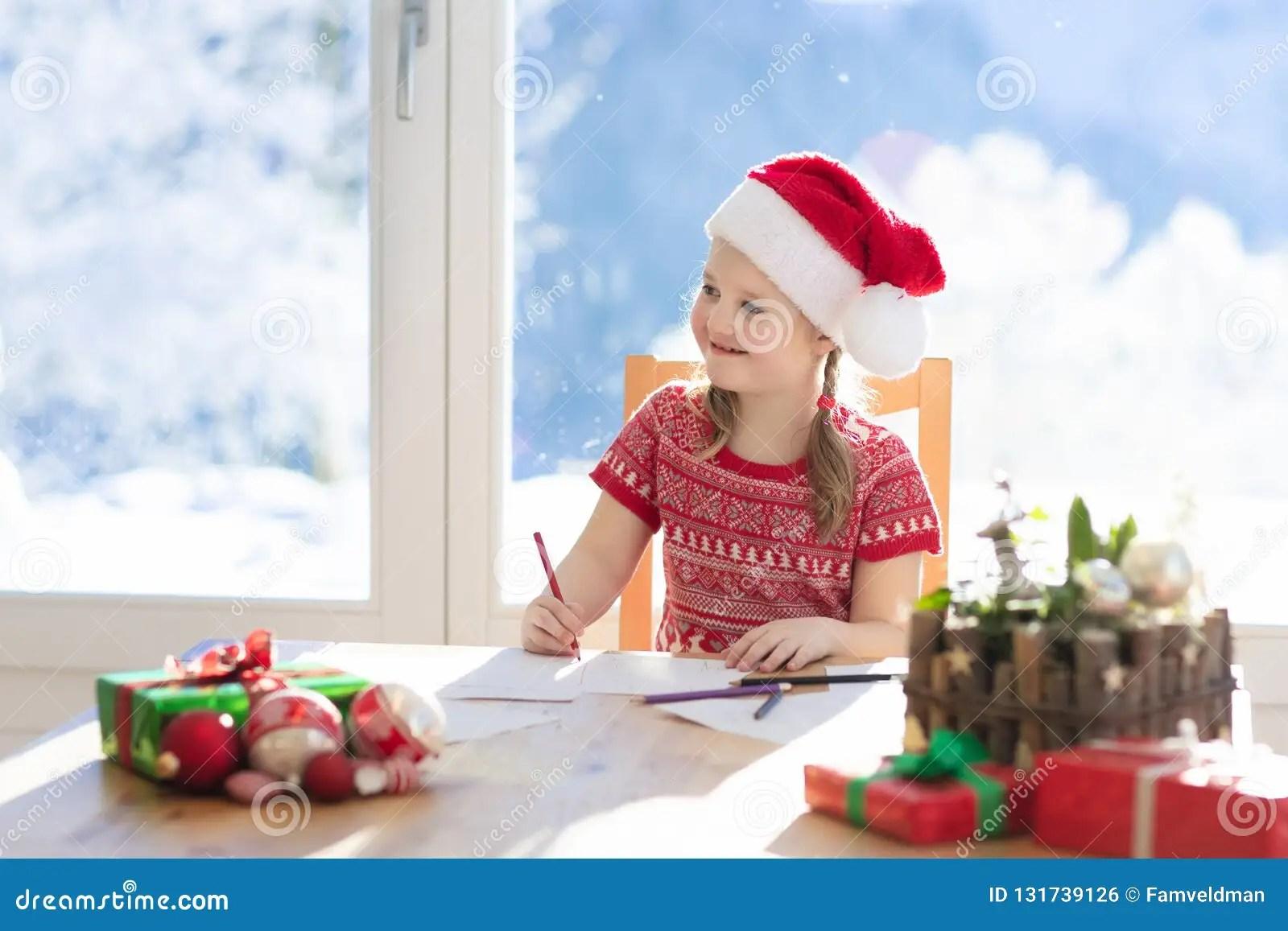 Child Writing Letter To Santa On Christmas Eve Kids Write