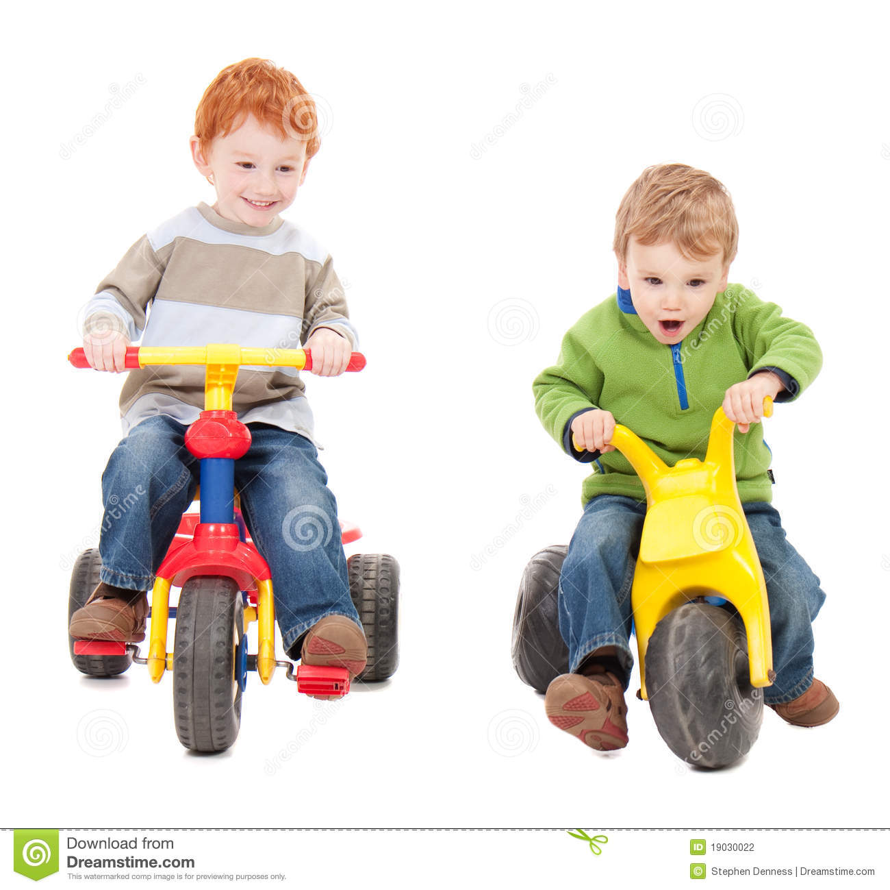 Children Riding Kids Tricycles Stock Photo