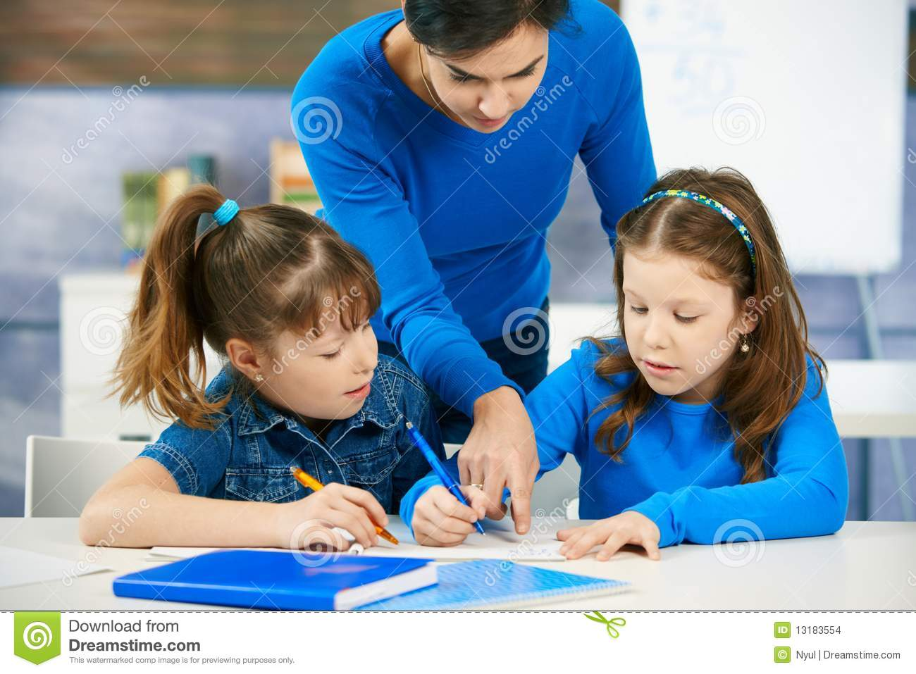 Children And Teacher In Classroom Stock Photo
