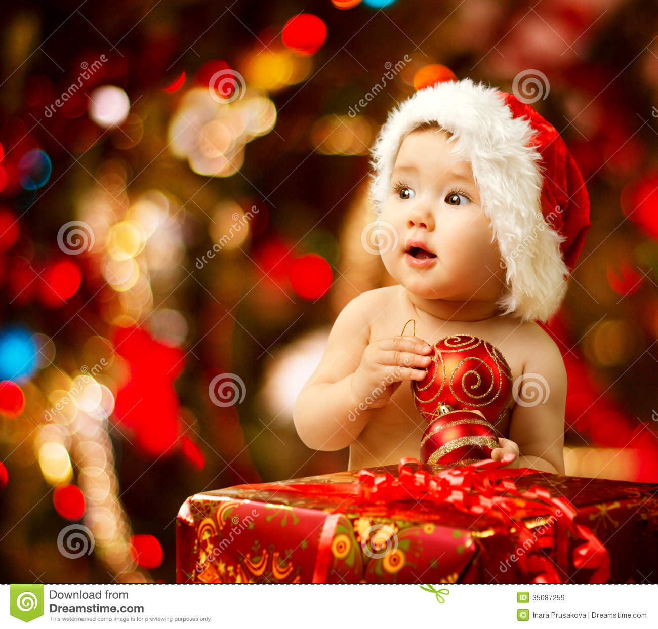 Christmas Baby In Santa Hat Red Present Gift Box Stock