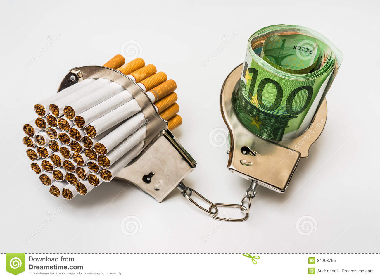 Cigarettes And Money With Handcuffs