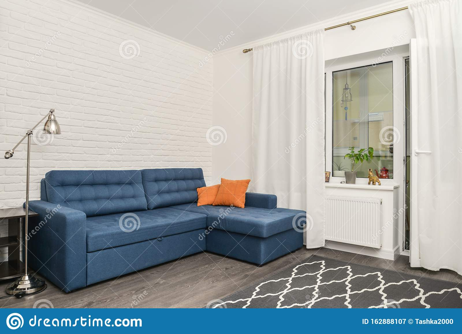 https www dreamstime com clean family room blue couch white brick wall yellow curtains design interior concept image162888107