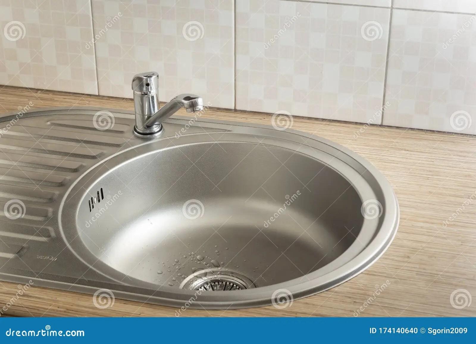 https www dreamstime com clean round metal kitchen sink faucet water drops leak clean round metal sink kitchen faucet water image174140640