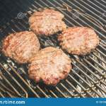 Close Up Of Beef Hamburger Cooking On A Charcoal Grill Stock Image Image Of Roasted Barbecuing 155156207