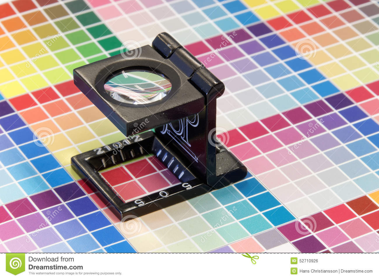 Close Up Of A Loupe On A Colorful Test Print Stock Photo