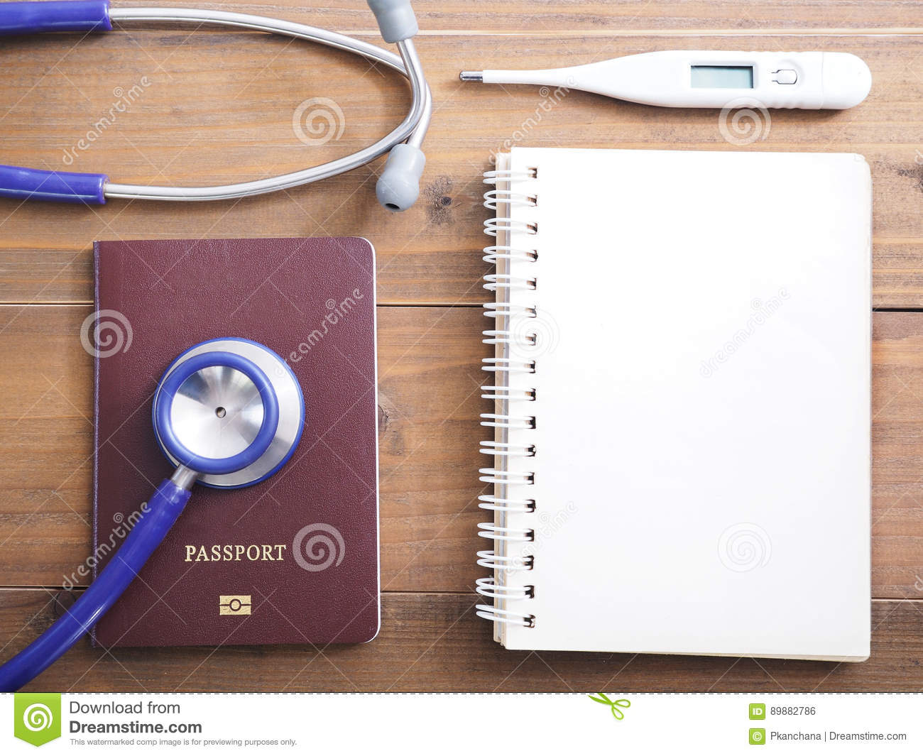 Close Up Stethoscope Passport Thermometer And Blank Notepad On Stock Photo