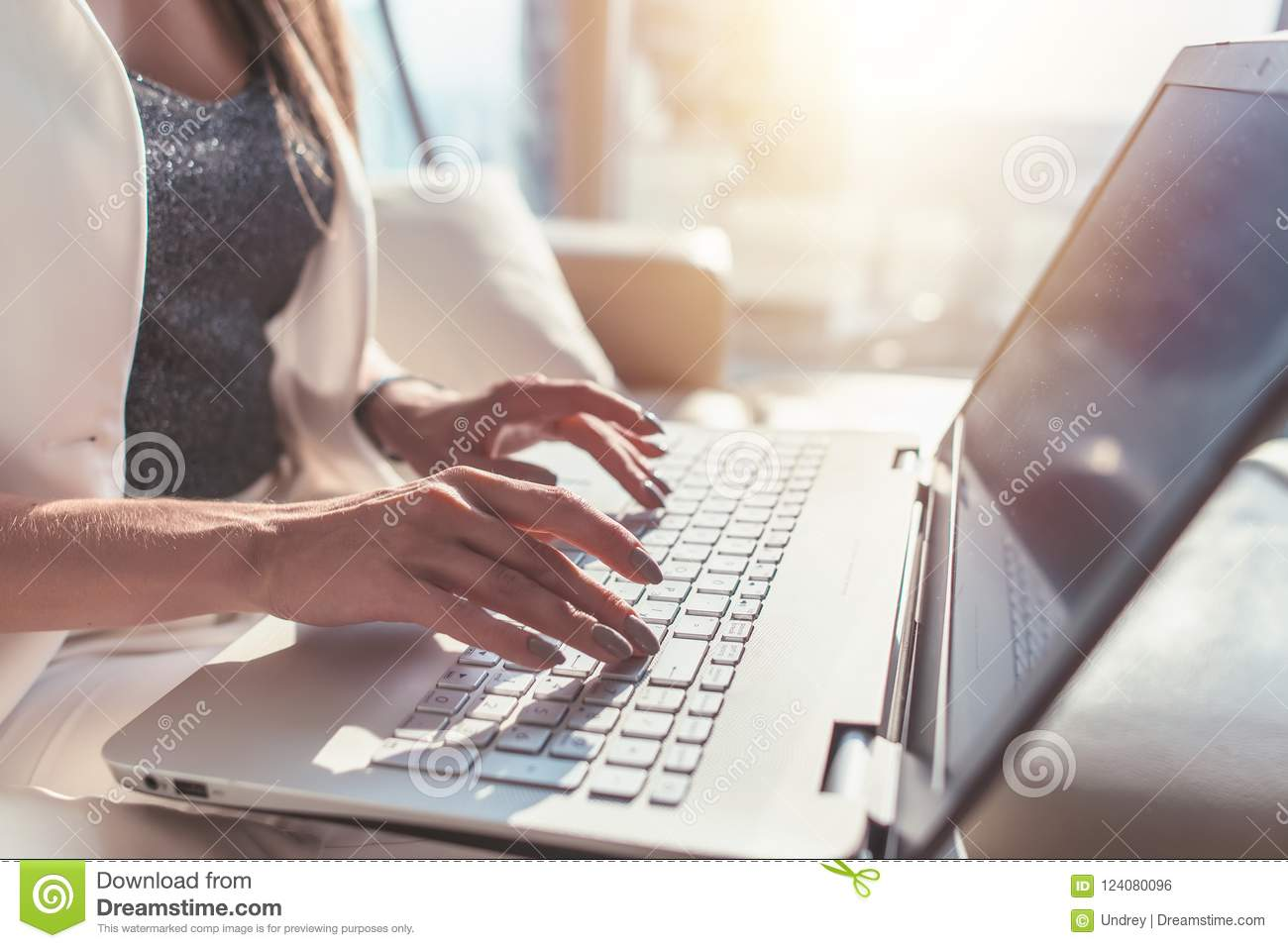 Closeup Of Woman Hands Typing On Laptop Keyboard Stock