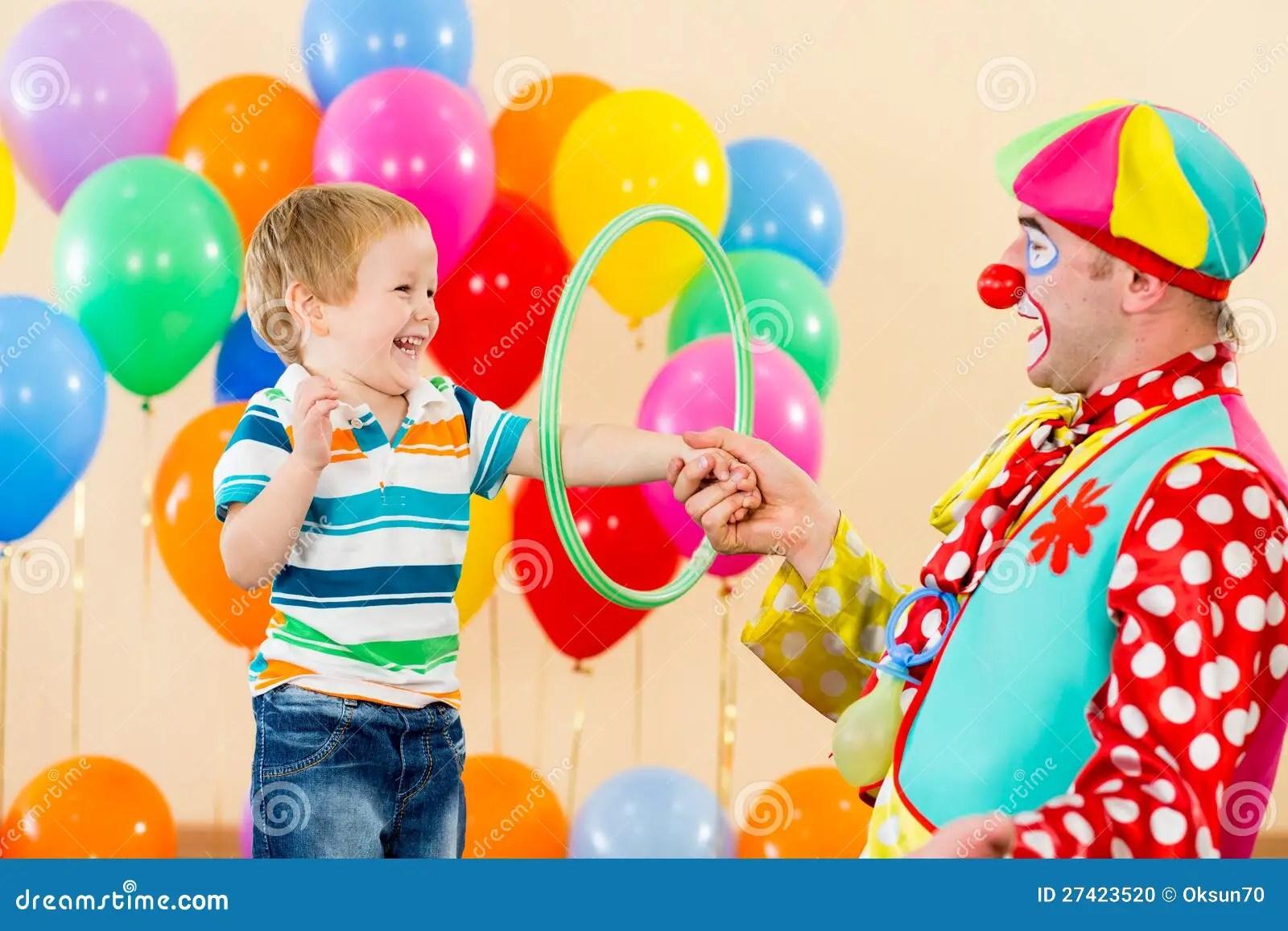 Clown Amusing Child Boy On Birthday Party Stock Photo