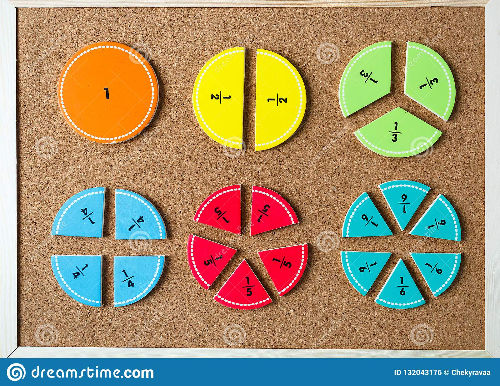 Colorful Math Fractions On Brown Wooden Background Or