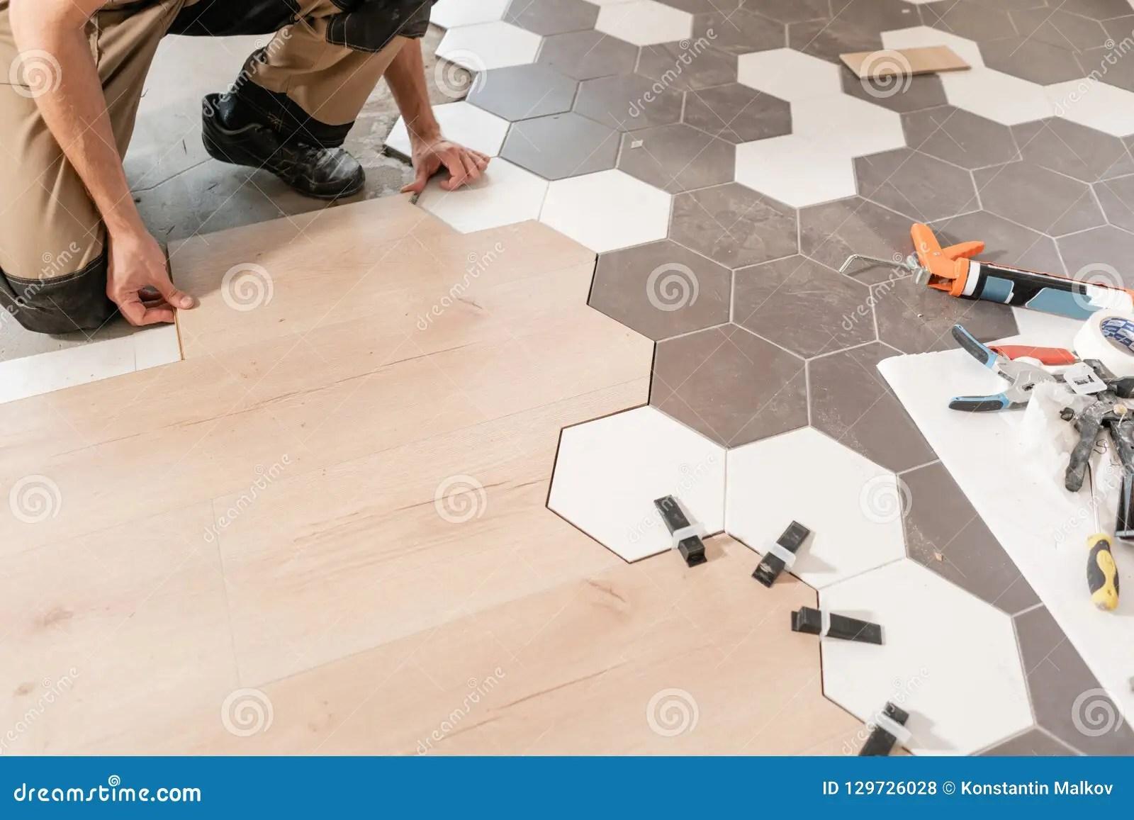 https www dreamstime com combination wood panels laminate ceramic tiles form honeycomb kitchen renovation male worker installing image129726028