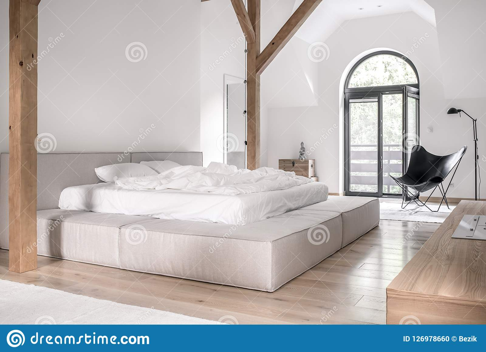 Stylish Bedroom In Modern Style With Wooden Beams Stock