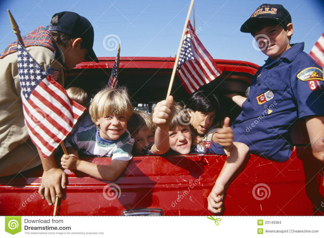 Cub Scouts Waving American Flags Editorial Stock Image