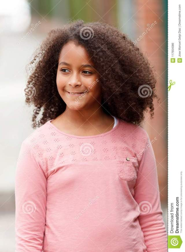 cute african american girl in the street with afro hair