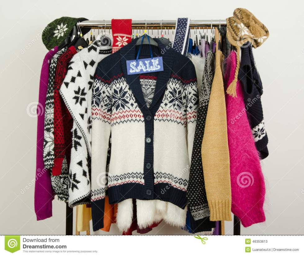 Cute Winter Sweaters Displayed On Hangers With A Big Sale ...