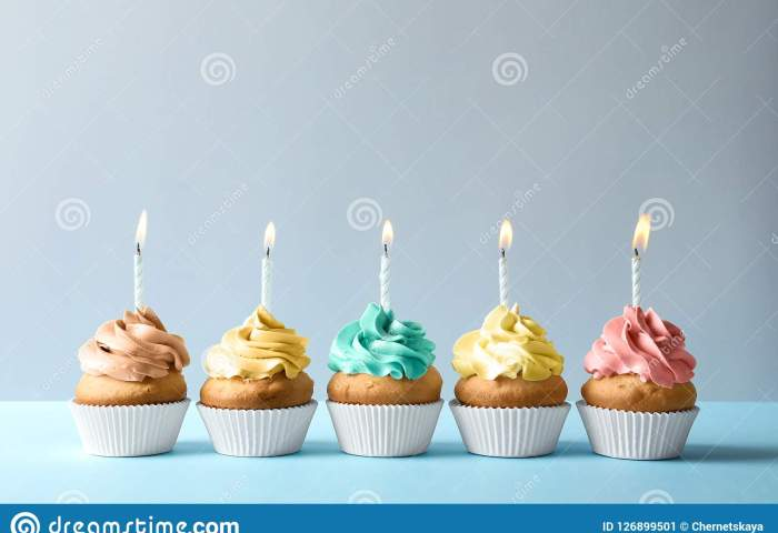 Delicious Birthday Cupcakes With Candles On Light Background Stock