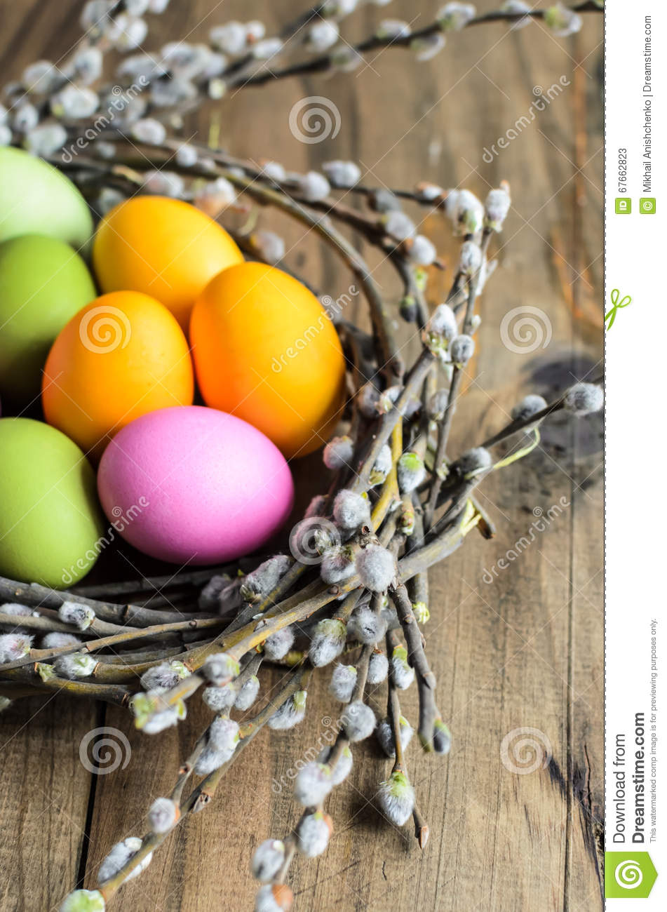 Easter Eggs In Willow Nest Flowers Over Wooden Rustic