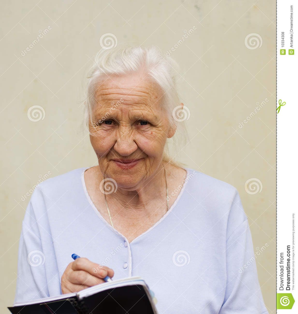Elderly Woman With Worksheet Stock Photo