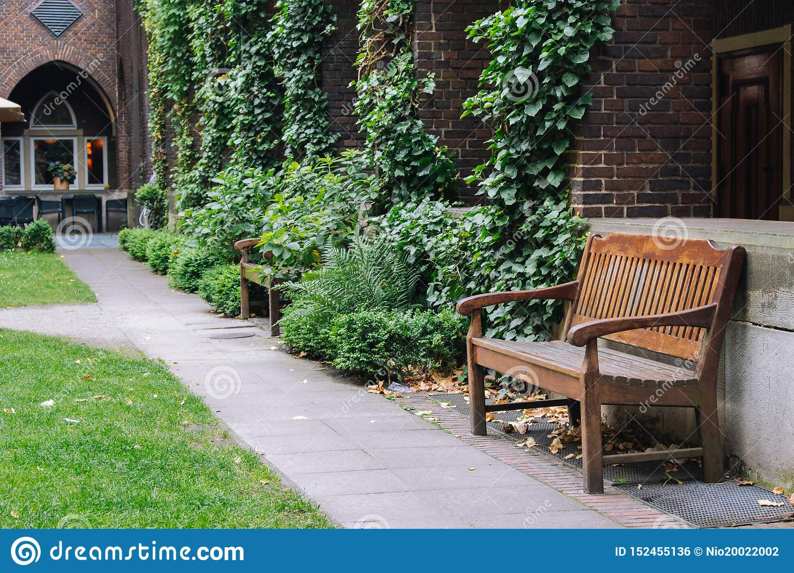 https www dreamstime com empty wooden bench cozy backyard summer patio outdoor furniture garden grass trees park relax peace concept travel image152455136