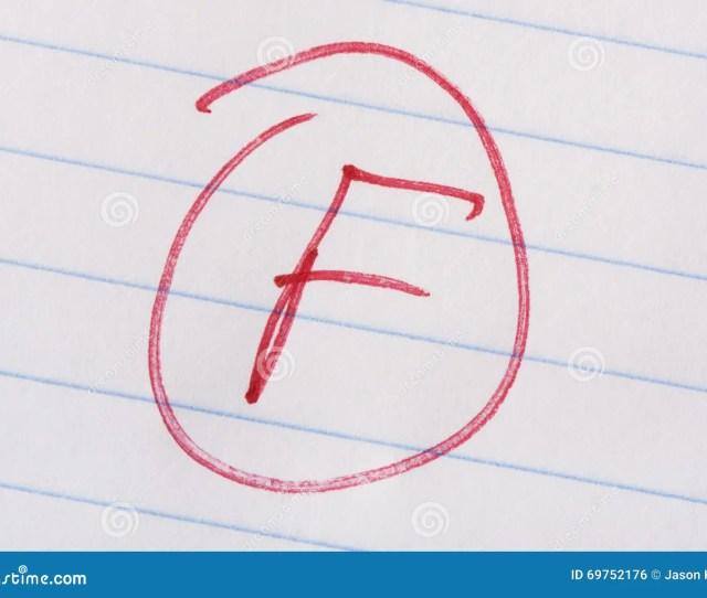 F Grade Written In Red Pen On Notebook Paper