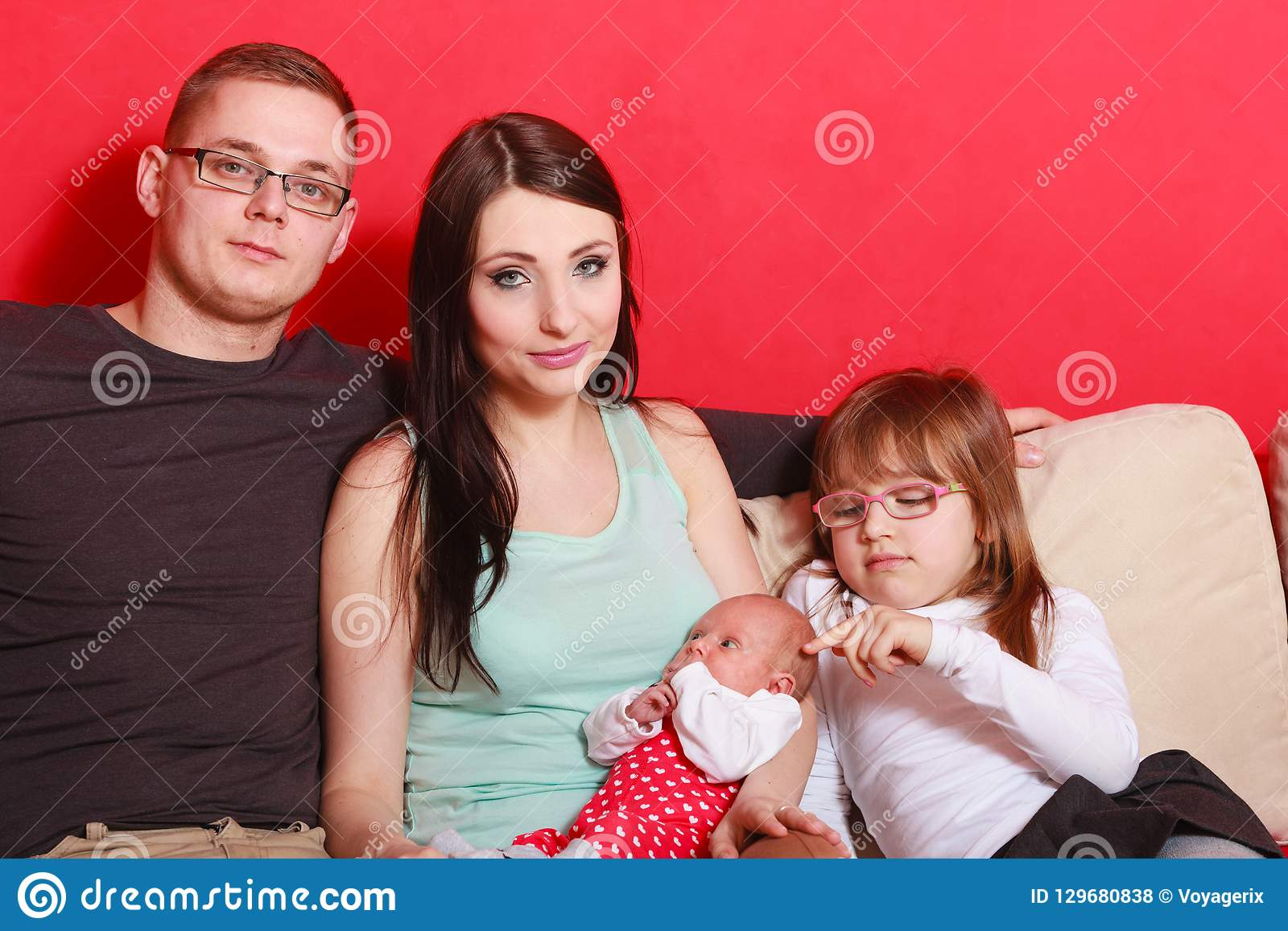 Family Photo Of Mother Baby Daughter And Father Stock