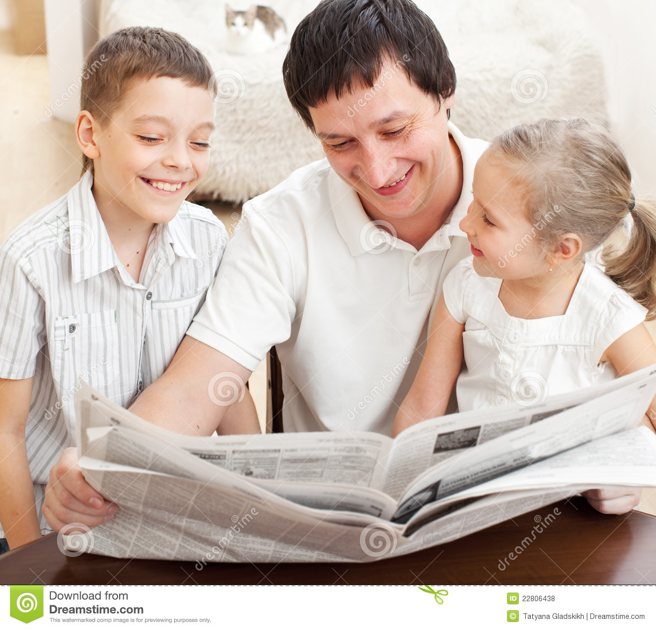 Family Reading A Newspaper Stock Photo Image Of Newspaper