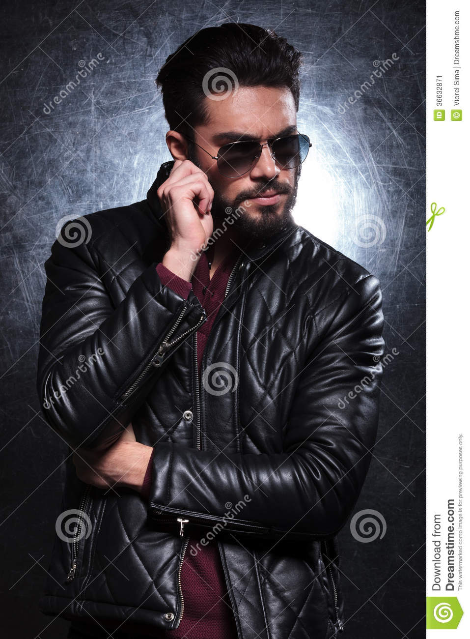 Fashion Man In Leather Jacket And Sunglasses Pulling His