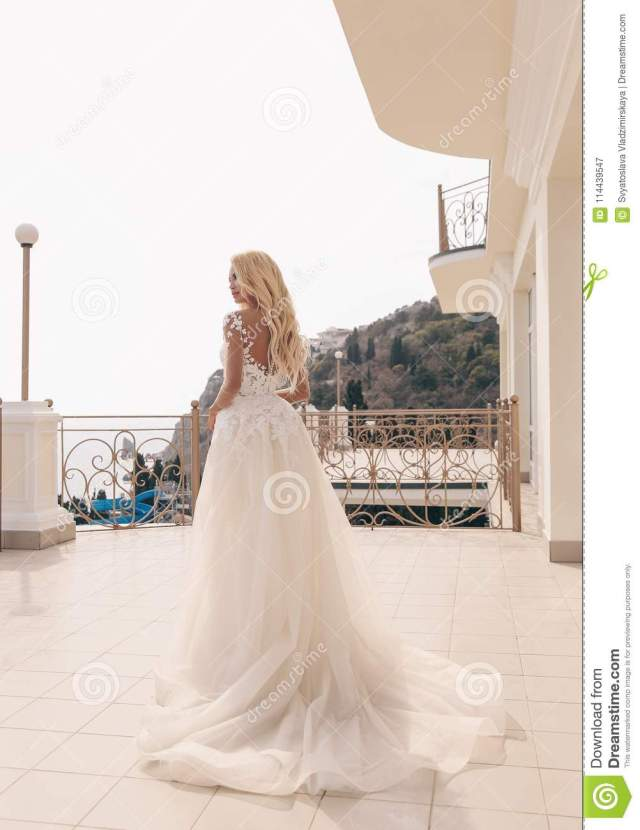 beautiful sensual woman with blond hair in luxurious wedding