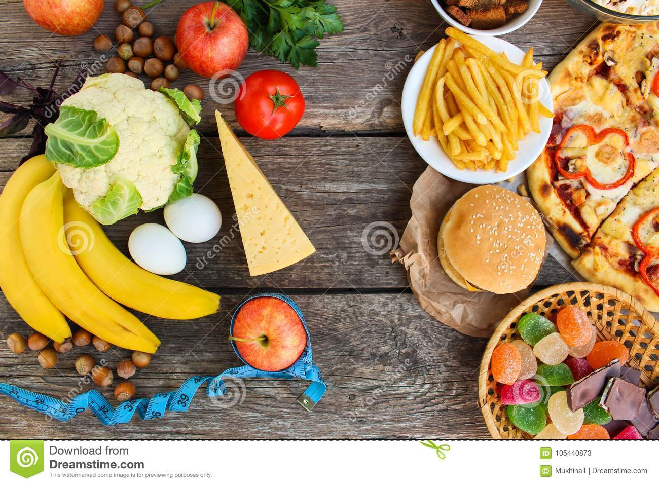 Fastfood And Healthy Food On Old Wooden Background
