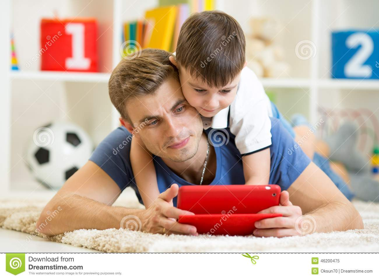 Father And Son Kid Play With Tablet Computer Stock Image