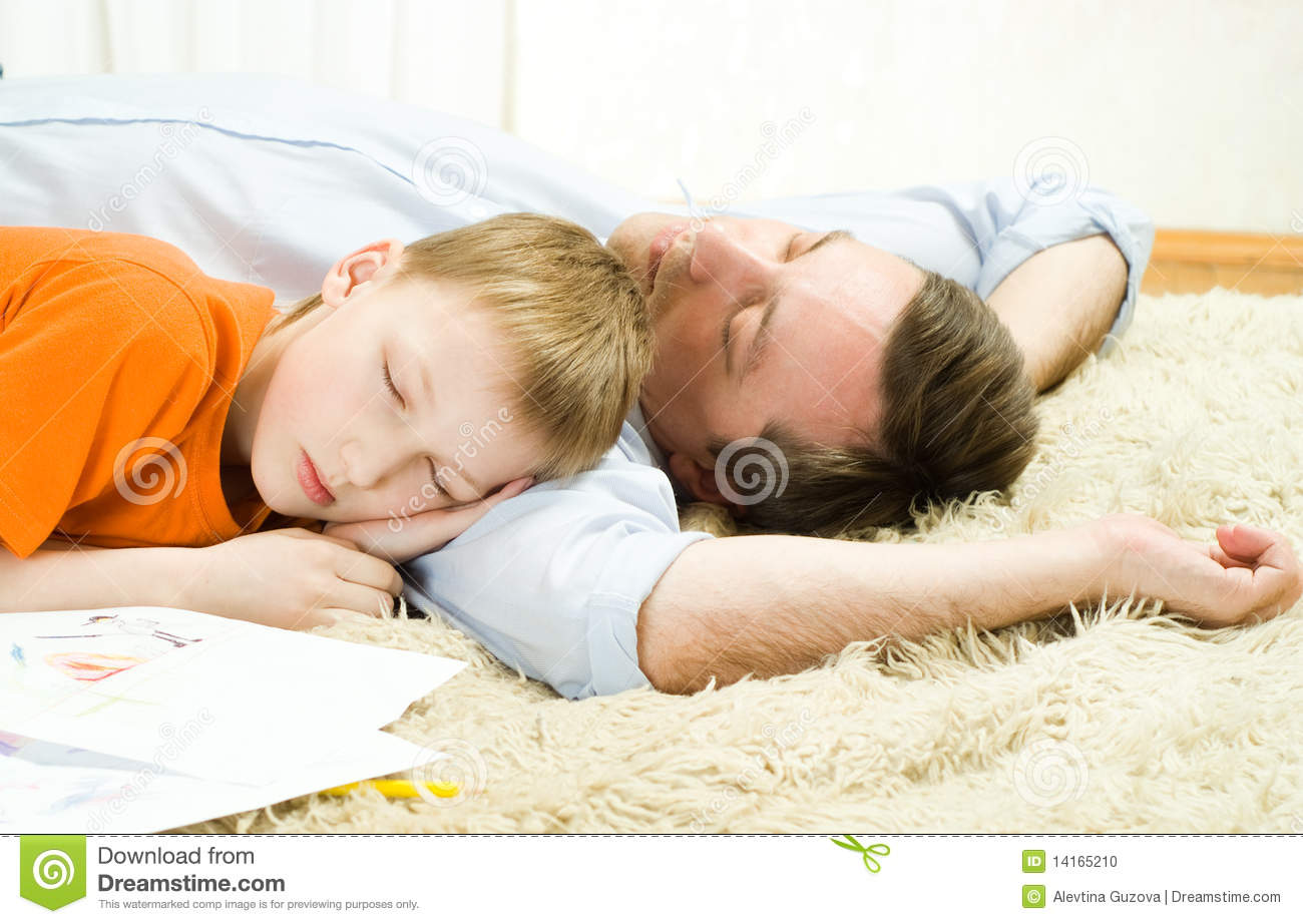 Father With Son Sleeping Stock Photo Image Of Casual
