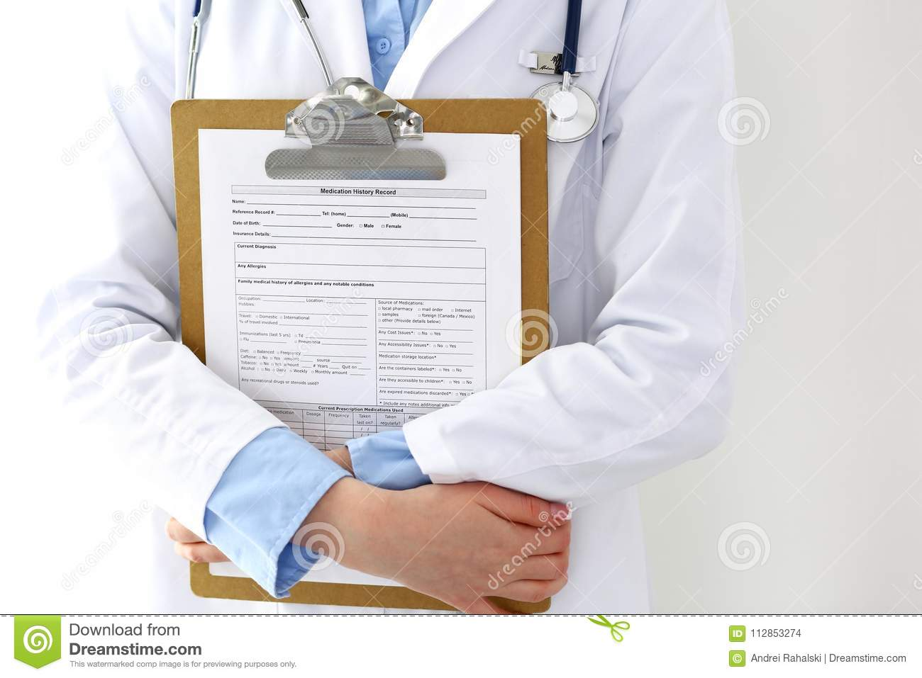 Female Doctor Filling Up Medical Form On Clipboard Closeup