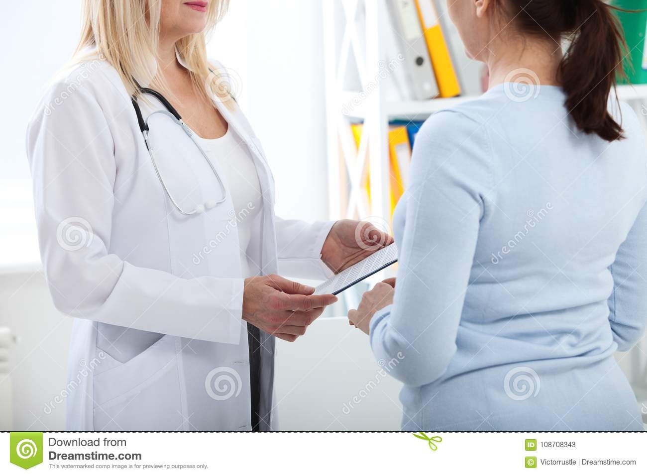Female Doctor Holding Application Form While Consulting