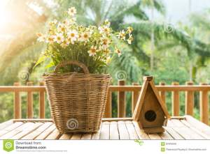 Flowers In Basket And Small Bird House Made Of Wood On A Bamboo Stock Photo Image Of House Nature 87970200