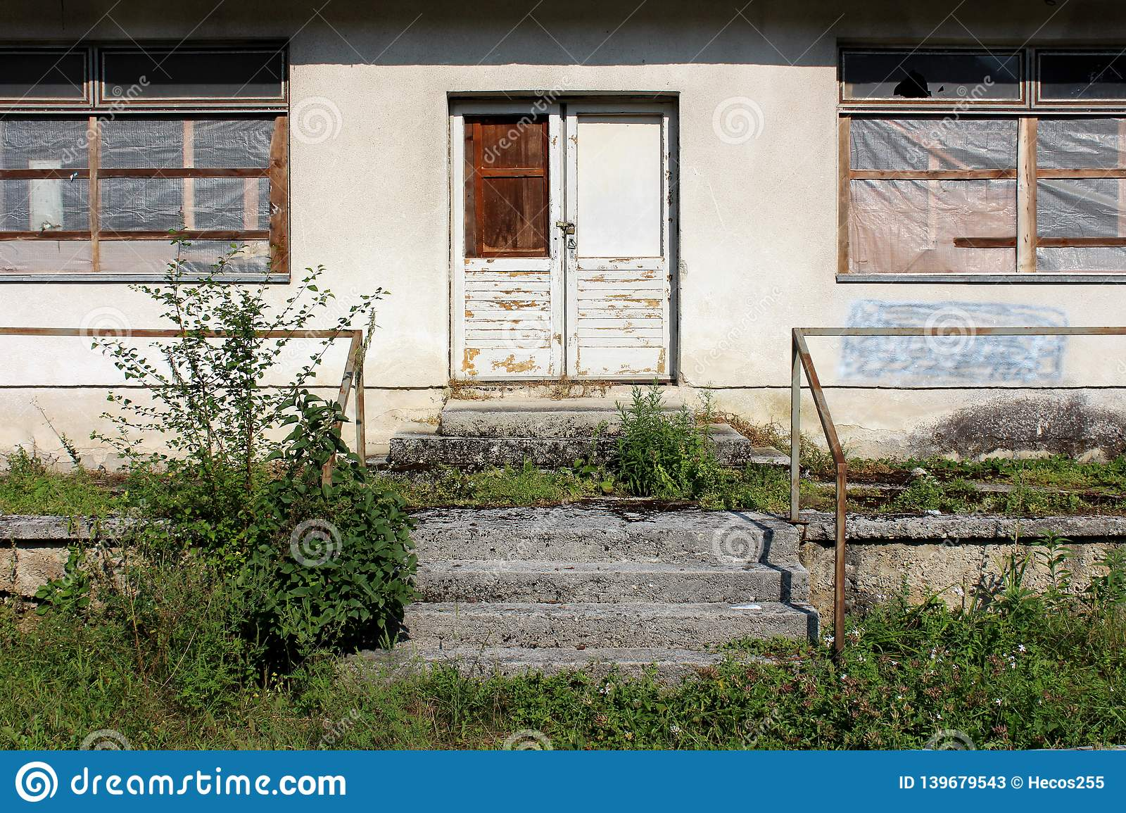Front Entrance To An Abandoned House With Destroyed