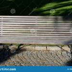 Garden Park Bench Metal Comfortable With Construction With Ergonomic Curves Of Thin Wood Slats Without Visible Screws Gray Brown Stock Photo Image Of Cobblestone Garden 189556290