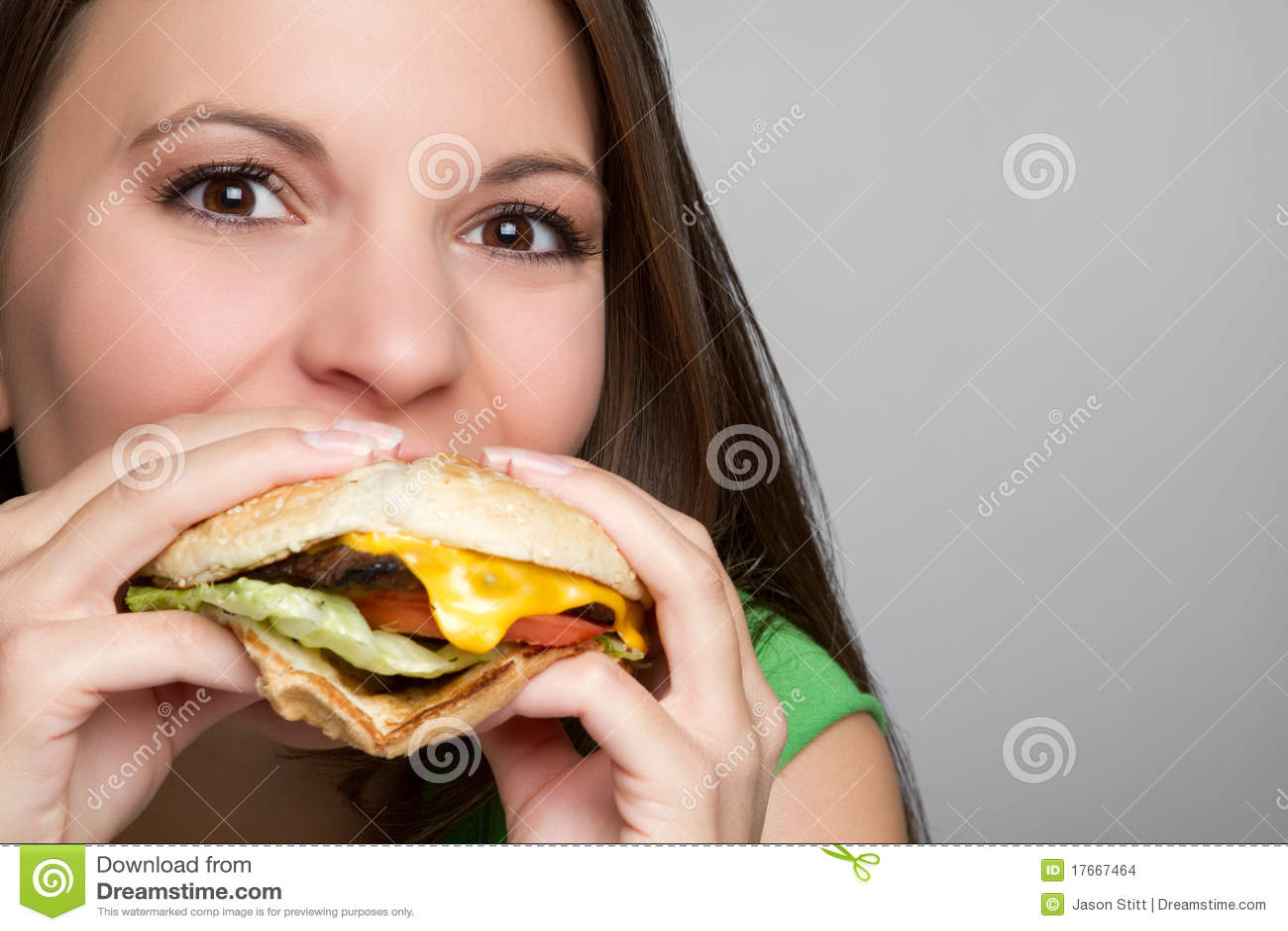 Girl Eating Hamburger Stock Photo Image Of Face Hungry