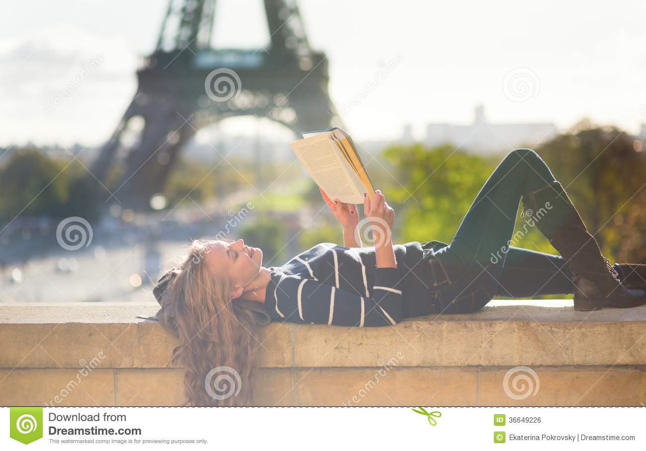 Girl Reading A Book In Paris Stock Photo
