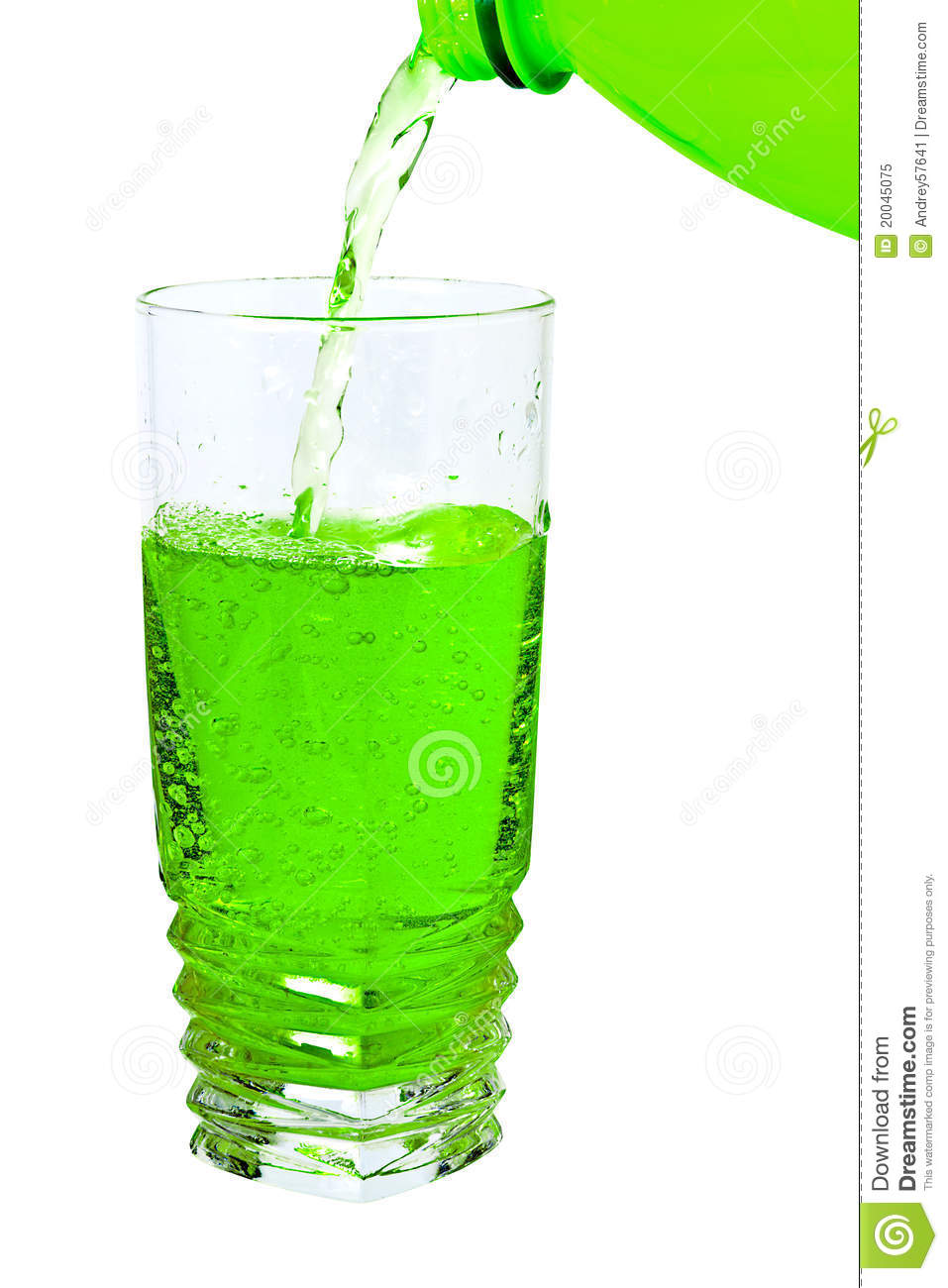 Green Soda In A Tall Glass Pour From The Bottle Royalty