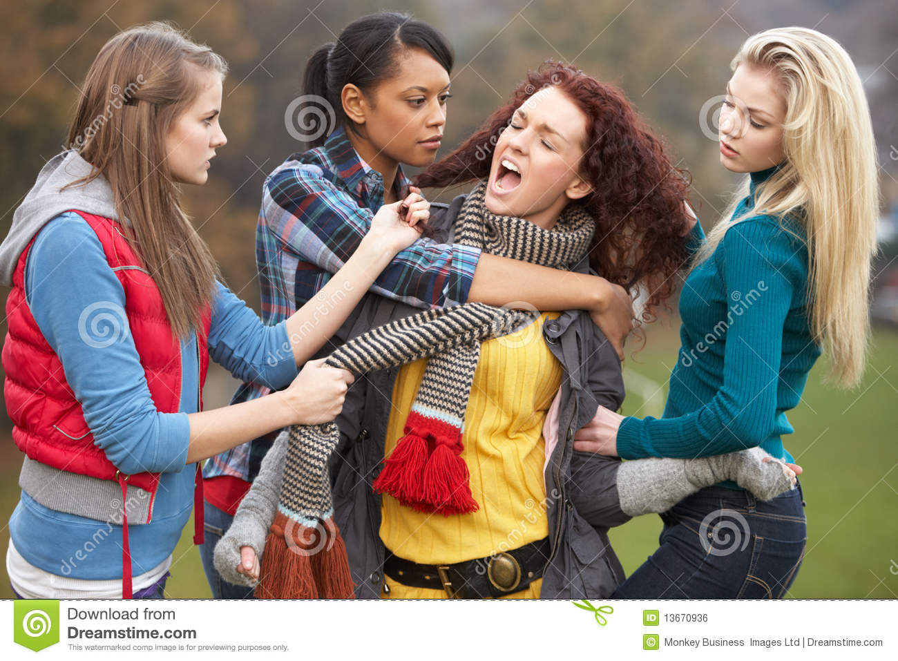 Group Of Female Teenagers Bullying Girl Royalty Free Stock