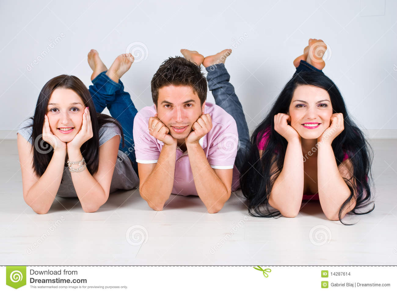 Group Of Friends In A Row Lying On Floor Stock Photo